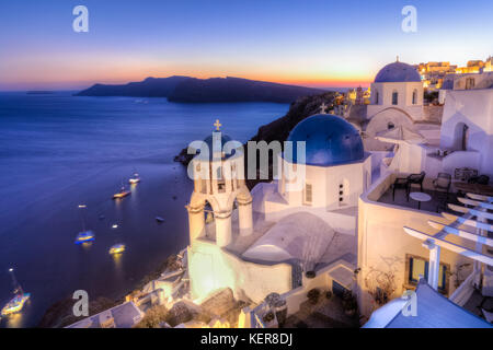 Traditional greek village of Oia at dusk, Santorini island, Greece. - Stock Photo