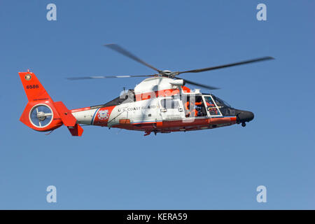 Coast Guard MH-65 Dolphin helicopter from Air Station San Francisco in flight. - Stock Photo