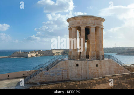 The Great Siege Bell Memorial in the Grand Harbour in Valletta, Malta. - Stock Photo