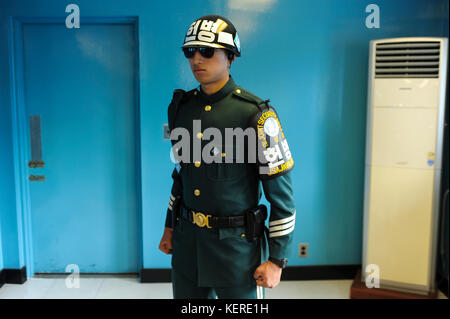 02.05.2013, Panmunjom, South Korea, Asia - A South Korean soldier stands guard in a defensive Taekwondo posture - Stock Photo