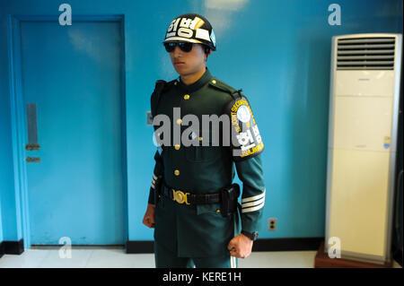 02.05.2013, Panmunjom, South Korea, Asia - A South Korean soldier stands guard in a defensive Taekwondo posture inside one of the blue DMZ barracks.
