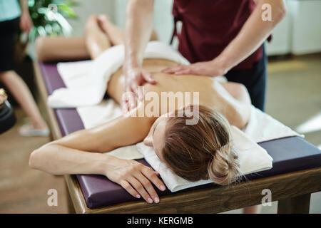 Young Woman Enjoying Massage - Stock Photo