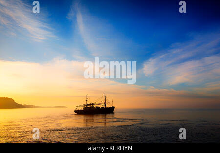 'Harvest Seeker' SUNRISEMussel Boat at Dawn, Fishing on the County Wexford side of Waterford Harbour, Ireland - Stock Photo