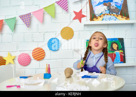 Funny Little Girl Making Christmas Decorations - Stock Photo