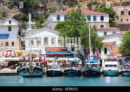 The view of the yachts and cruise boats in the old harbour of Kaleici and the sea and white buildings with red tile - Stock Photo