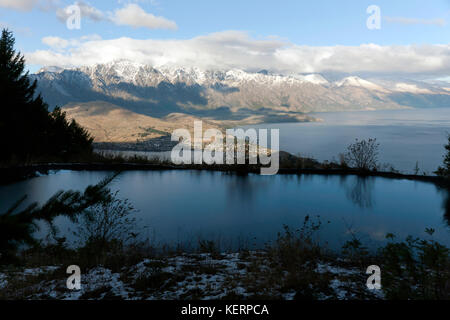 Evening view of Lake Wakatipu, from the walking trail, above the Top of the Skyline Gondola, Ben Lomond - Stock Photo