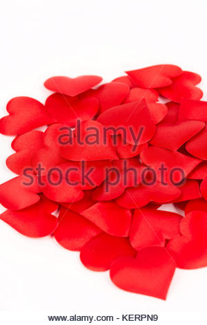 Pile of red hearts isolated above white background. Love and romantic red hearts background. - Stock Photo