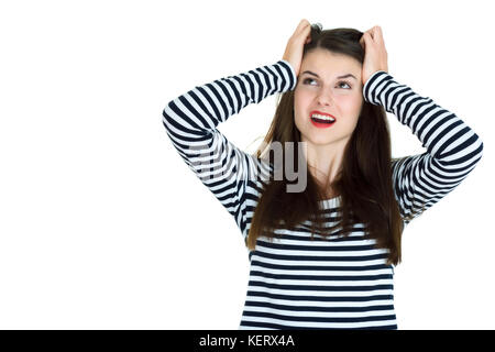 Portrait of a frustrated angry woman screaming out loud and pulling her hair out isolated on white background - Stock Photo