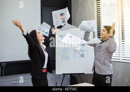 Asian businessmen and businesswomen Success and winning concept - happy team with raised up hands celebrating the - Stock Photo