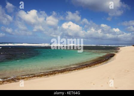 Hiking on Ka'ena Point Trail, Oahu Hawaii - Stock Photo