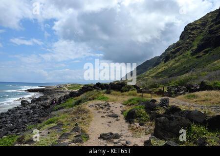 Hiking on Ka'ena Point Trail, Oahu Hawaii - Stock Photo