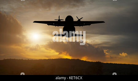 Airplane silhouette flying in the sky on sunset ,soft focus and blurry - Stock Photo
