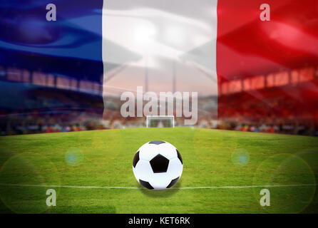 Soccer Ball On Green Field of football stadium and stadium arena soccer field championship win for background merge with french flag Stock Photo