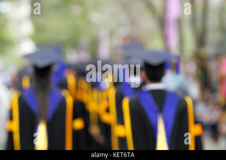 blurry of Graduates are walking the line to get a diploma - Stock Photo