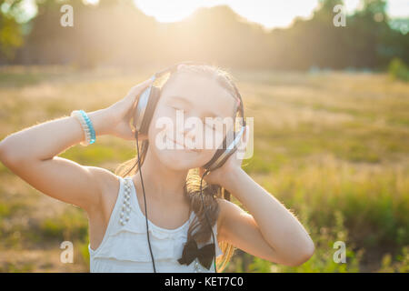 Funny girl listening music with headphones - Stock Photo