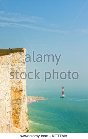 Cliff at Beachy Head, East Sussex, and lighthouse in haze - Stock Photo