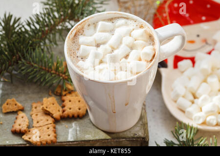 Hot Christmas cocoa in a white mug with marshmallow and spices. Holiday hot drink concept. - Stock Photo