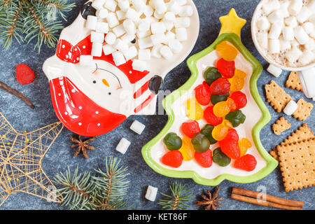 Christmas decoration: holiday plates with sweets. - Stock Photo