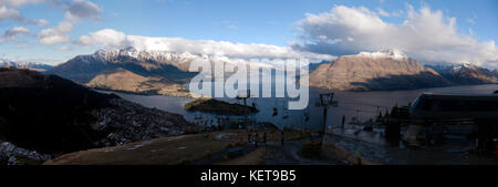 Panoramic, evening view of Queenstown and Lake Wakatipu, from the Top of the Skyline Gondola, Ben Lomond - Stock Photo