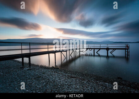 Sunrise at Loch Lomond, North of the town of Luss - Stock Photo