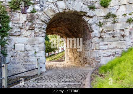 The Cobbled Pathway under the Iron Bridge in  Shropshire.  The image was taken on the 30 July 2013 - Stock Photo