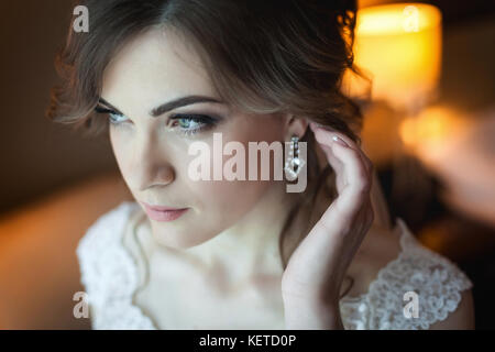 Young bride getting ready for the wedding - Stock Photo