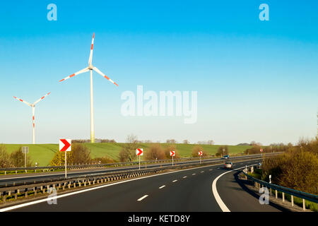 Speed road freeway in Germany with high walls on the sides - Stock Photo