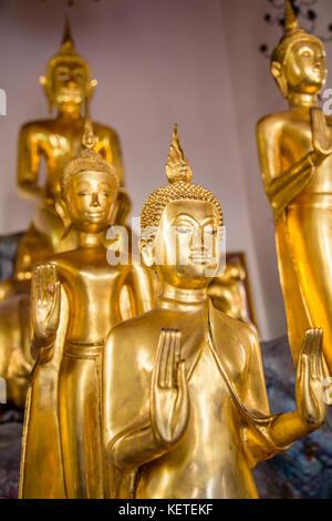 Golden Buddhas at Wat Pho, Bangkok, Thailand - Stock Photo