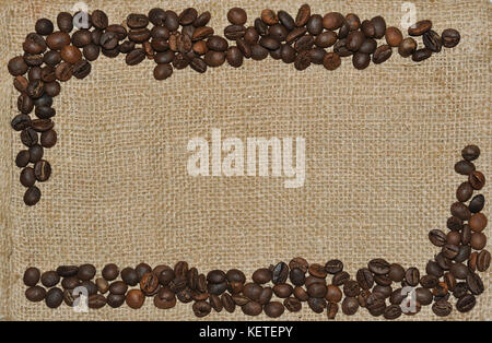 Coffee bean frame on jute background. - Stock Photo