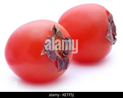 Fresh ripe persimmon over white background - Stock Photo