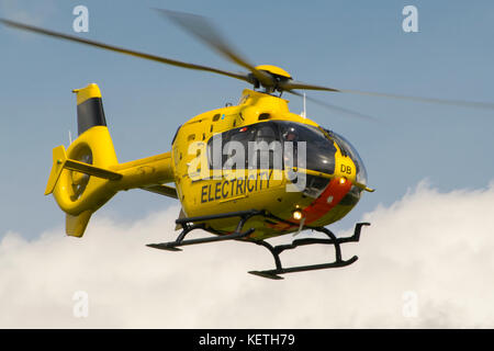 Western Power distribution's eurocopter they use to check powerlines - Stock Photo