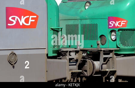 SNCF logo on two diesel locomotives type BB  in railway station, regional, Auvergne, Massif-Central, France, Europe, - Stock Photo
