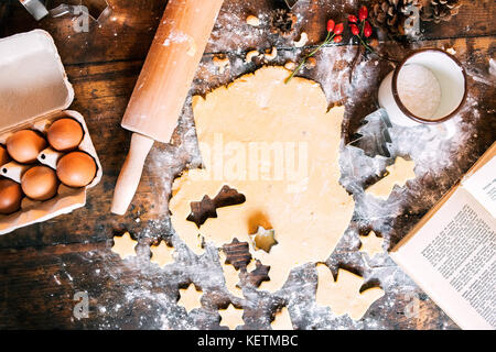 Baking gingerbread cookies at Christmas time. - Stock Photo