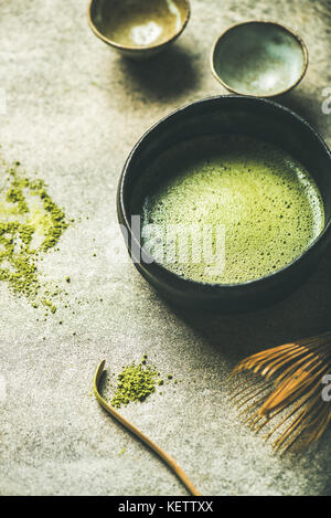 Flat-lay of freshly brewed Japanese matcha green tea in bowl - Stock Photo