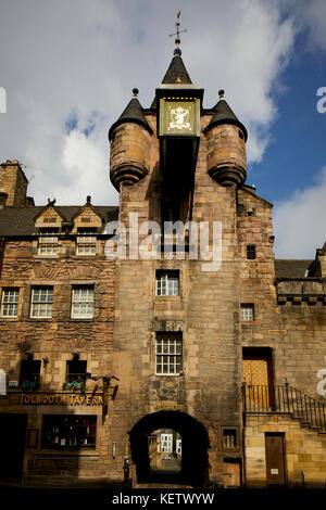 ornate street clock on Historic  Edinburgh, Scotland, Canongate Tolbooth used for  toll collection also has been - Stock Photo