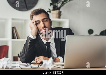 sleeping overworked businessman - Stock Photo