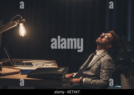 sleeping businessman in office - Stock Photo
