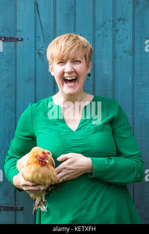 Lady with her bantam chicken pets - Stock Photo
