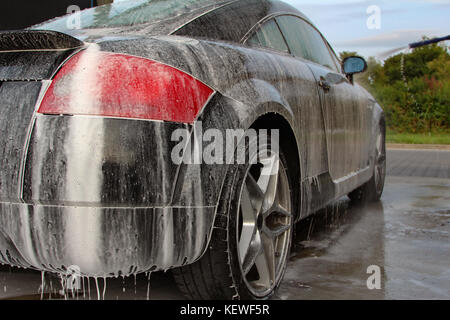 Car detailing : Car Washing with Foam Shampoo. - Stock Photo