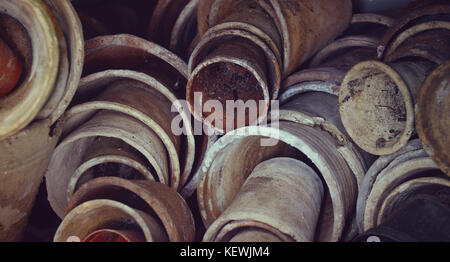 Vintage hipster background of plenty old cracked ceramic pots for gardening. - Stock Photo