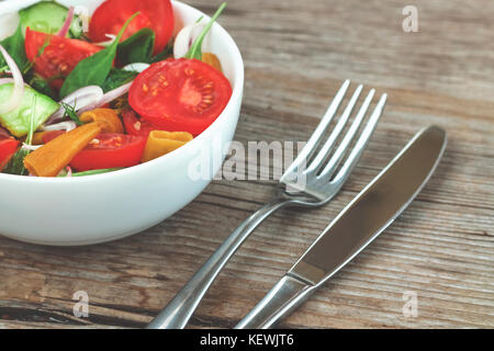 Vegetarian food. Fresh vegetable salad with arugula. wooden background - Stock Photo