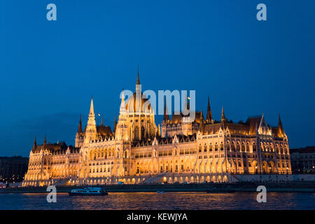 Horizontal view of the Parliament Building at night in Budapest. - Stock Photo