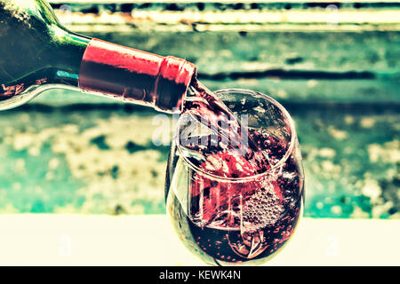 Christmas, New Year. pouring red wine. Wine in a glass. selective focus, motion blur, Red wine in a glass. Sommelier - Stock Photo