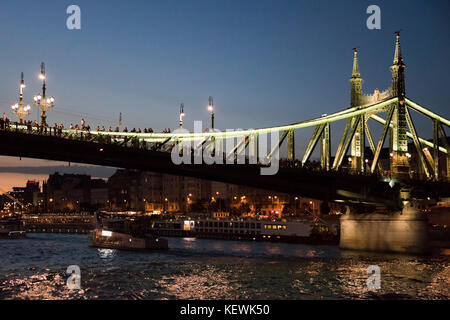 Horizontal view of people partying on the closed Liberty Bridge in Budapest. - Stock Photo