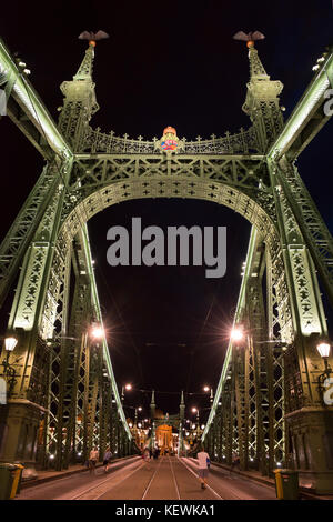 Vertical view of Szabadság híd or Liberty Bridge at night in Budapest. - Stock Photo