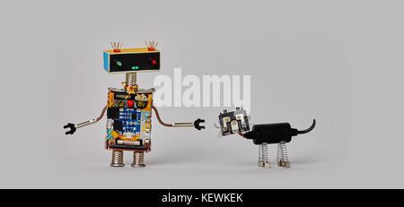 Funny robotic character black cyborg cat pet. gray background - Stock Photo
