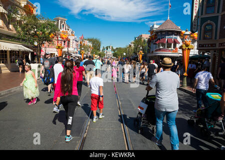 ANAHEIM, CA - OCTOBER 16, 2017: Disneyland's Main Street crowded with guests on a very busy day at the theme park. - Stock Photo