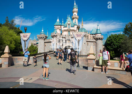 ANAHEIM, CA - OCTOBER 16, 2017: Guests walk through the landmark castle at Disneyland Theme Park Resort in California. - Stock Photo