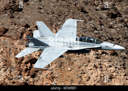 United States Marines McDonnell Douglas F/A-18C Hornet from the VMFAT-101 Sharpshooters squadron, Marine Corps Air Station Miramar, California flies low level through the Jedi Transition, Star Wars Canyon, Death Valley National Park, California, United States of America Stock Photo