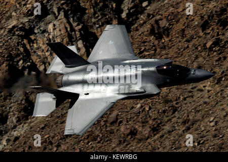 Lockheed Martin F-35A Lighting II (OT-002) from the 323 Squadron, Royal Netherlands Air Force, flies low level through - Stock Photo